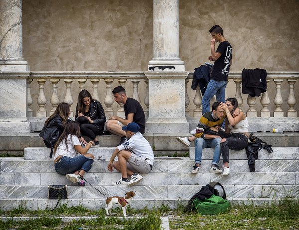 Young adults gather in the church plaza, Lavagna, Italy thumbnail