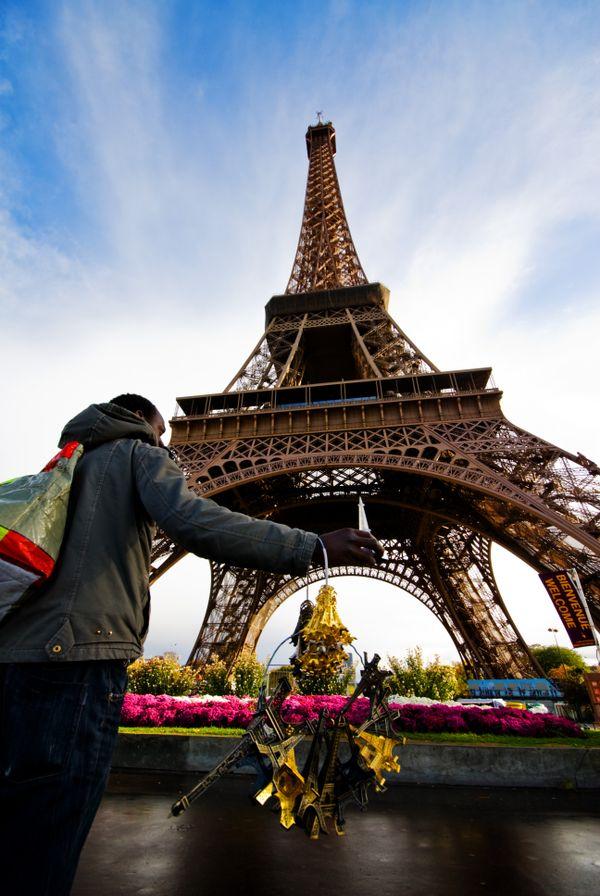 Salesman of the Eiffel Tower, Paris, France. thumbnail