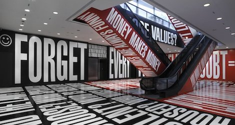 The artist's black, white and red phrases titled Belief+Doubt exist outside the traditional galleries.