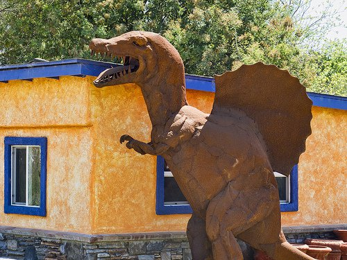 A Spinosaurus sculpture near an ice cream shop in California.