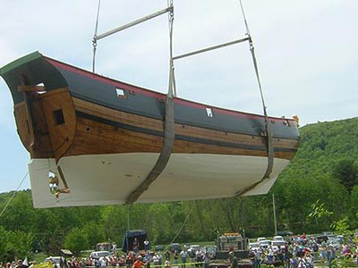 Volunteers prepare to place the Onrust into the Hudson River.