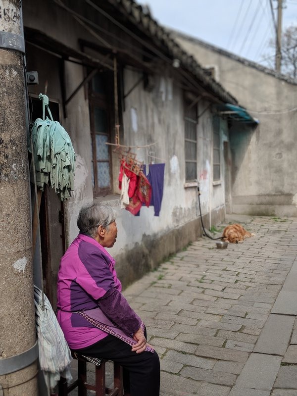 Woman resting mid morning with dog thumbnail