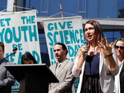 Kelsey Rose Juliana, one of 21 plaintiffs in Juliana v. United States, speaks at a rally in Portland, Oregon on Tuesday, June 4, 2019. That day, three federal judges heard arguments for the case.