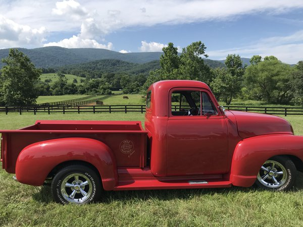 Red truck against a beautiful Virginia mountain and skyline thumbnail