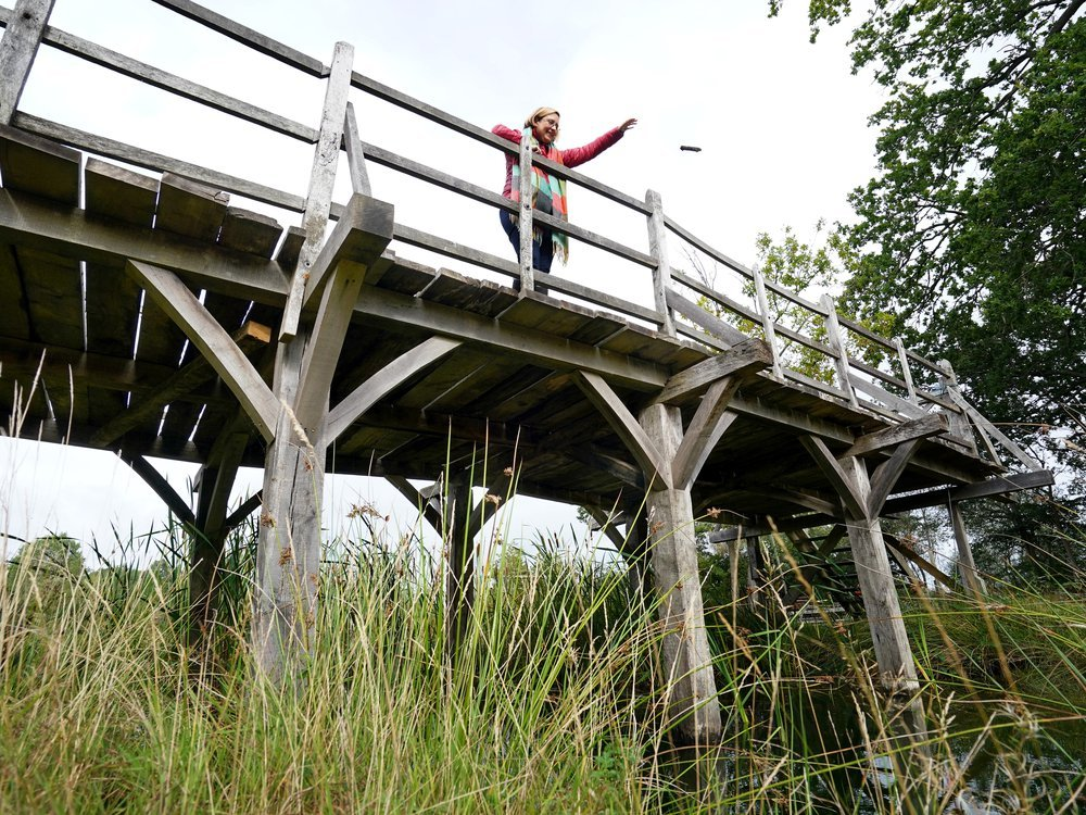 Silke Lohmann of Summers Place Auctions stands on the original Poohsticks Bridge from Ashdown Forest,
