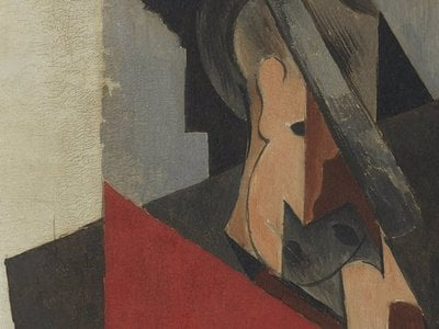 A close-up view of Picasso's Seated Man (1917) shows the deep cracks running along its surface.