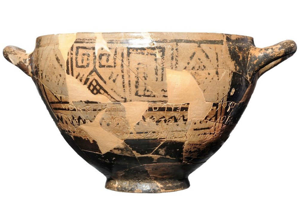 clay cup featuring black geometrical designs