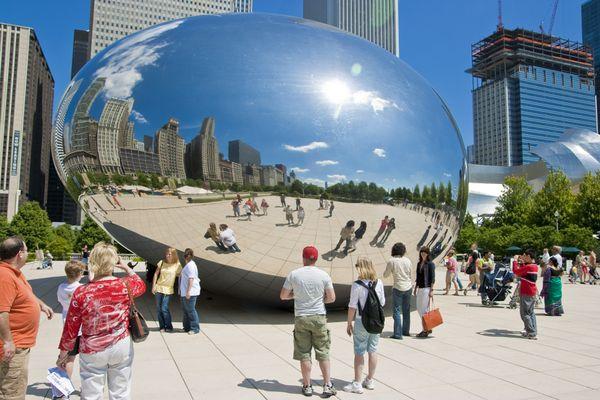Visitors stare at Cloud Gate sculpture in Chicago's Millennium Park thumbnail