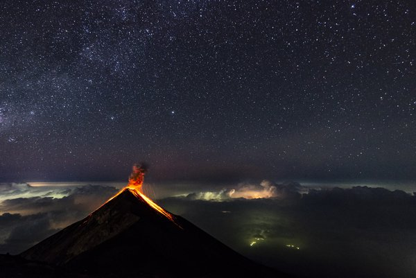 Milky way above the Fuego volcano, and lightnings below thumbnail