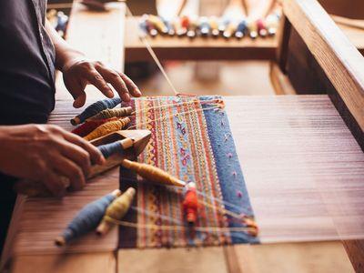 Zapotec weaver Porfirio Gutiérrez at work in his studio. (Photo courtesy of the artist)