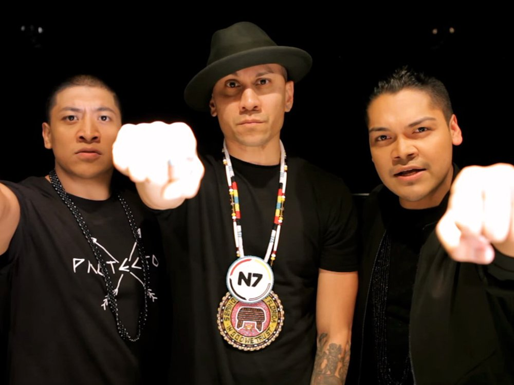 """Fromleft to right: Zack """"Doc"""" Battiest, Taboo of the Black Eyed Peas, and Spencer Battiest in the music video"""