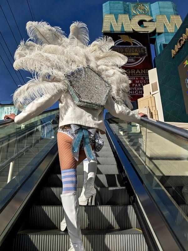 Showgirl street performers riding an escalator in Las Vegas thumbnail