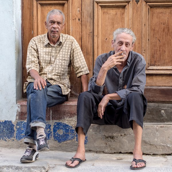 Two Men sitting on step Havana Cuba thumbnail