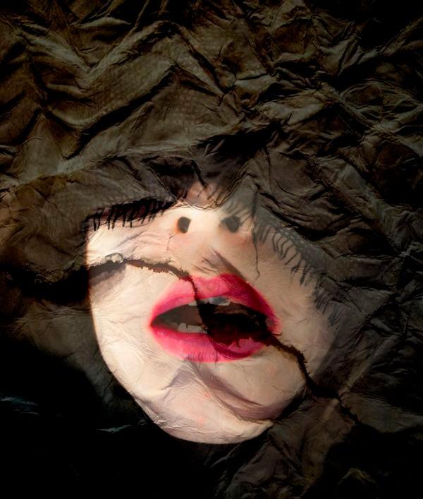 Woman lips expressing desire on a broken surface thumbnail