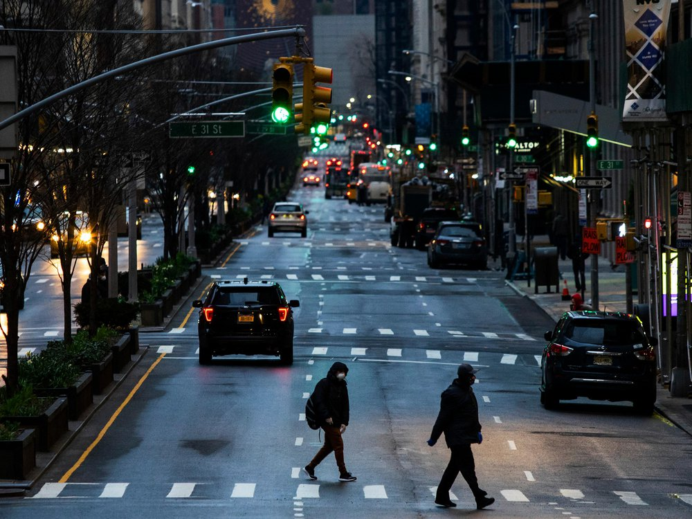 People cross Park Avenue after it was announced that some streets will be closed off as lockdown continues in response to the coronavirus outbreak on March 27, 2020 in New York City.