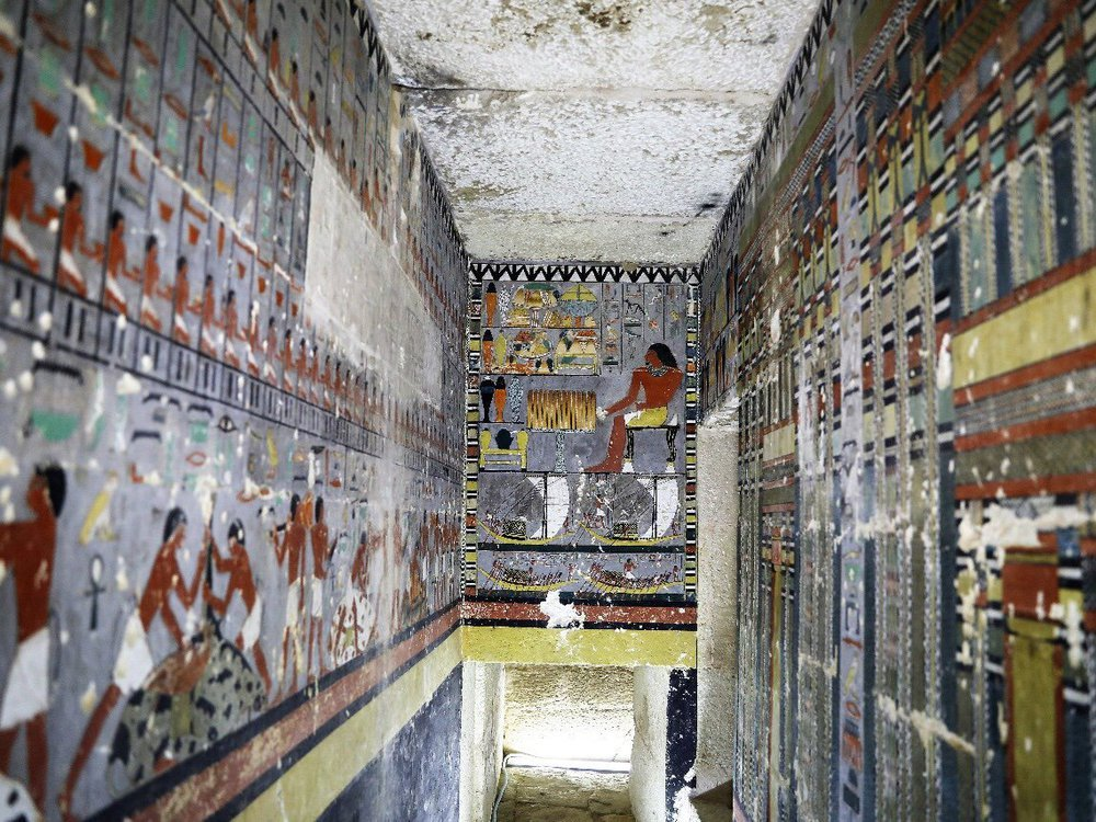 interior of tomb with colorful paintings
