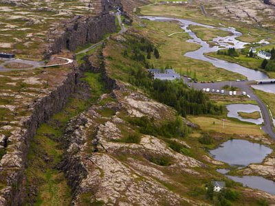 The earth is splitting apart in the middle of Iceland along a ridge that runs north to south through the middle of the Atlantic Ocean.