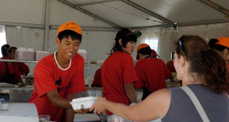 A visitor samples southeast Asian food at the 2011 Smithsonian Folklife Festival