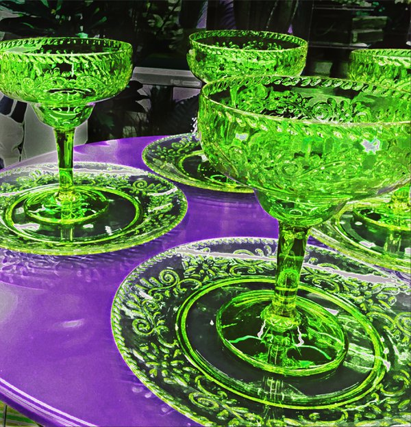 Green Plastic Dishwares on Purple Table thumbnail