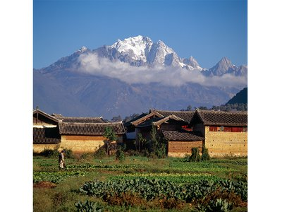 The highest summit of the Jade Dragon (Yulong Xueshan) from what in 1985 was close to the center of the old town of Lijiang, China.