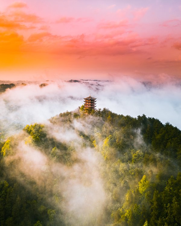 Sunset over the temple in clouds thumbnail
