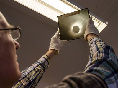 A photographic plate of the 1919 total solar eclipse, taken by Andrew Claude de la Cherois Crommelin and Charles Rundle Davidson during an expedition to Sobral, Brazil. The 1919 eclipse was used by Arthur Eddington, who observed it from the island of Principe off the west coast of Africa, to provide the first experimental evidence of Einstein's theory of relativity.