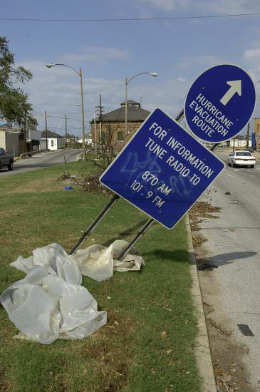 Sign marking an evacuation route, tilted by the storm. Photograph by Hugh Talman.