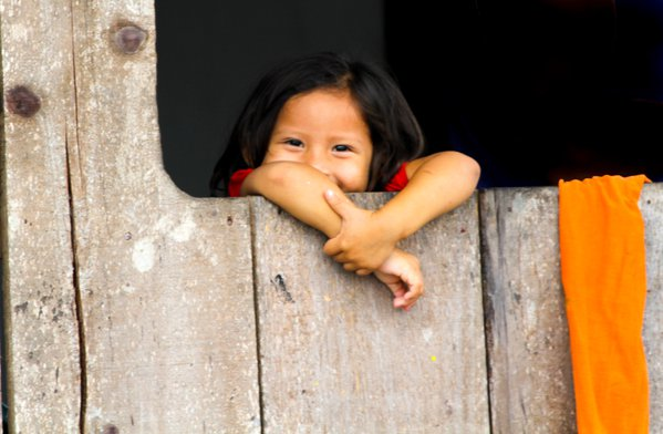 Watching the world - young girl in the slums of Iquitos Peru thumbnail