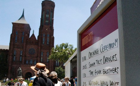 Smithsonian Castle serves as a backdrop to the the Motor City stage at the 2011 Smithsonian Folklife Festival.