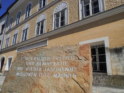 """A stone in front of Adolf Hitler's birthplace reads, """"For peace, freedom and democracy. Never more fascism. Millions of dead warn."""""""