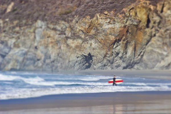 A Surfer with a Red Board in Big Sur thumbnail