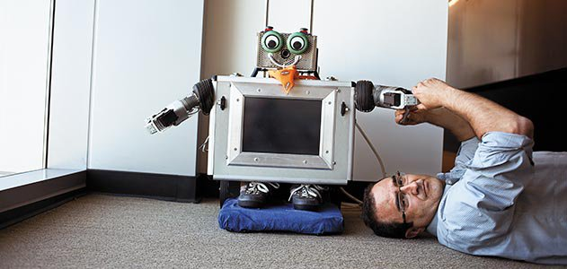 Javier Movellan with robot