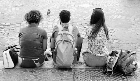 Three People Sitting in Piazza Navona thumbnail