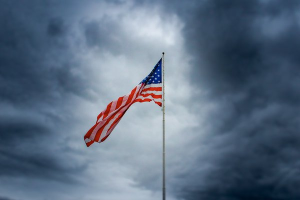 A windy day makes the American flag blow in the wind thumbnail