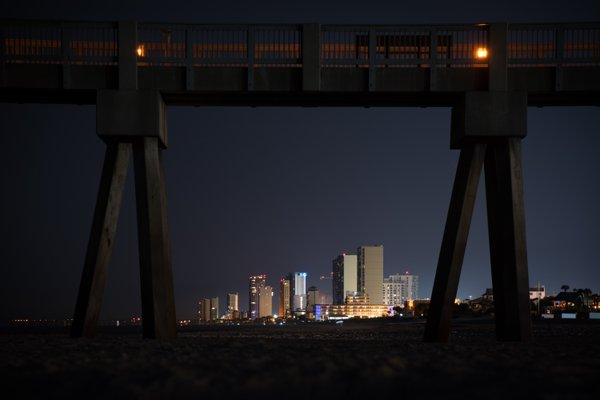 City through a pier lens thumbnail