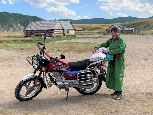 Mongolian Lady And Her Motorbike thumbnail