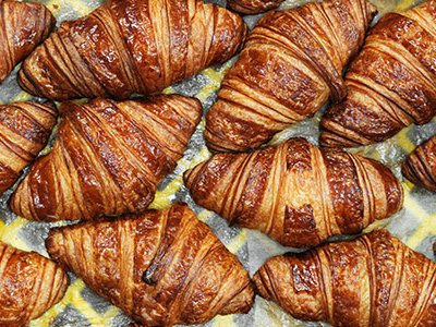 Croissants await delivery to stores inside the La Boulange Pine Street baking facility in San Francisco.
