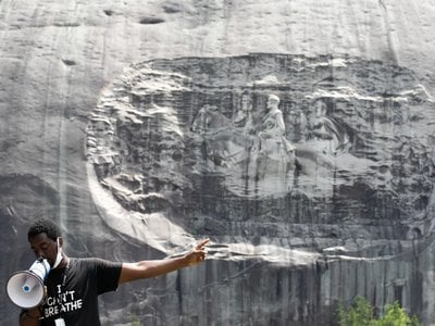 Organizer Quintavious Rhodes addresses Black Lives Matter protesters during a march in Stone Mountain Park on June 16, 2020. Activists have long called for Stone Mountain's carved relief of Confederate generals to be taken down.