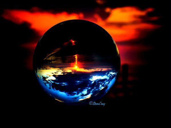 Sunset shot through lens ball/Lake Michigan thumbnail