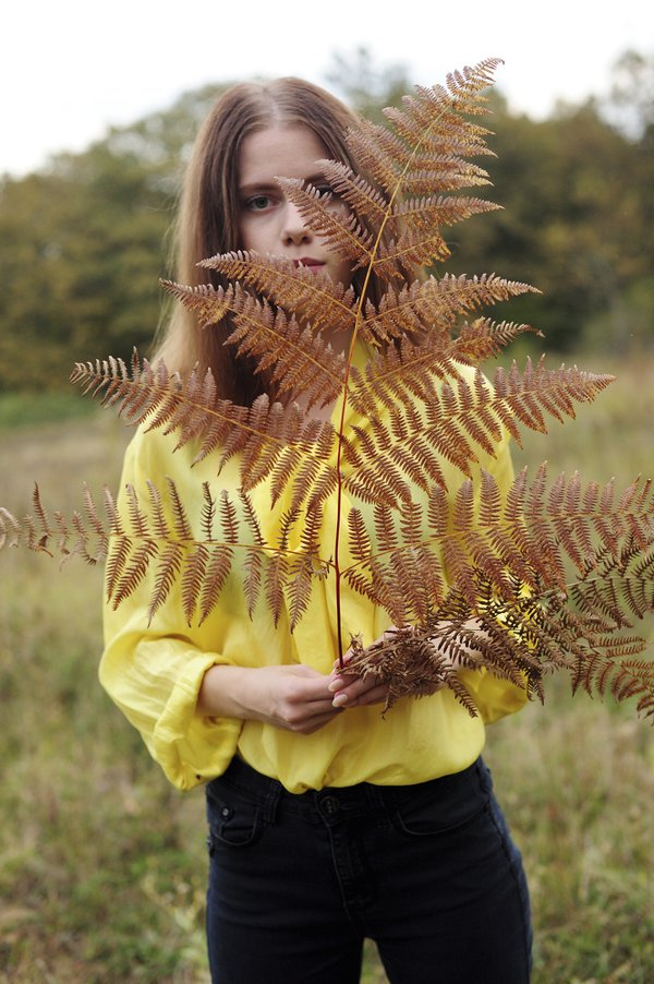 Girl with a branch of dry fern thumbnail