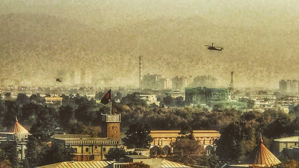 Blackhawk helicopters fly over downtown Kabul, Afghanistan and the Presidential Palace thumbnail
