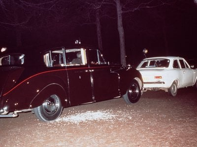 The aftermath of Ian Ball's attempt to kidnap Princess Anne. Ball's white Ford Escort is parked blocking the path of the Princess's Rolls Royce limousine.