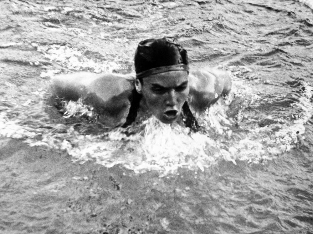 Éva Székely swims the 200-meter breaststroke at the Olympics