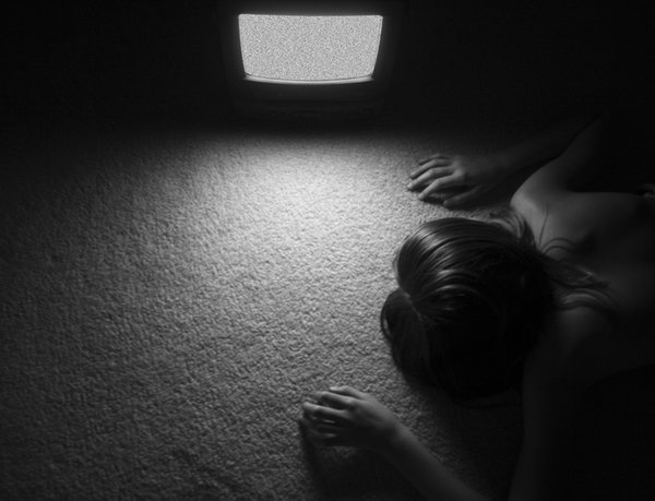 A girl fallen asleep in front of the television. thumbnail