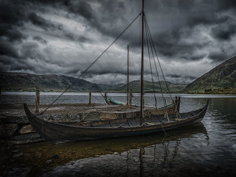 Long boat sits on a dock