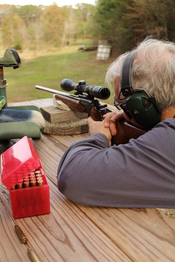 An older gentleman sighting-in a hunting rifle thumbnail