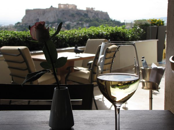 View of the Parthenon on the Acropolis in Athens from the rooftop terrace of the Hotel Grande Bretagne, the glass of wine catches perfectly the reflection of the Acropolis! thumbnail