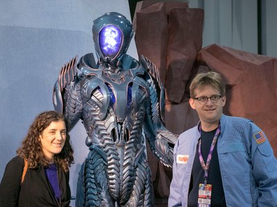 Awesome Con provided an opportunity for science fiction and real-life science to play off of one another. The Robot from Netflix's Lost in Space reboot (center) illustrates the former, while the NASA jacket of the con attendee on the right nods to the latter.