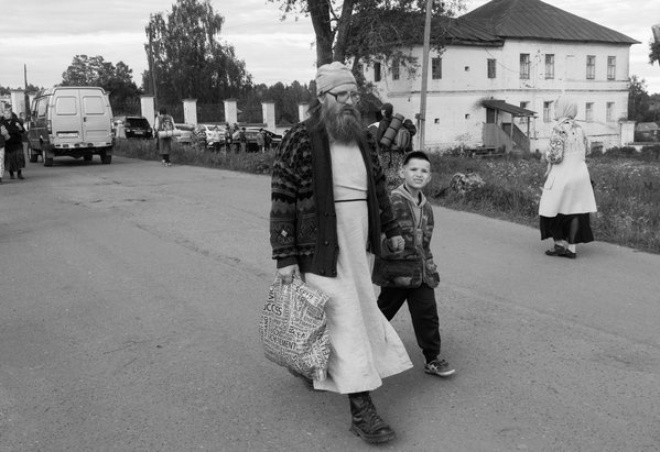 The small boy goes next to his father, a priest, after trekking, 35 km long thumbnail
