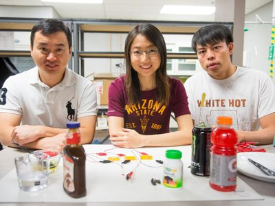 Hanqing Jiang (left) and his students, Wenwen Xu and Xu Wang, with their supercapacitor materials